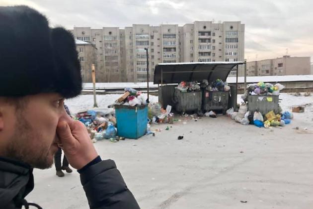 Александр Осипов у кучи