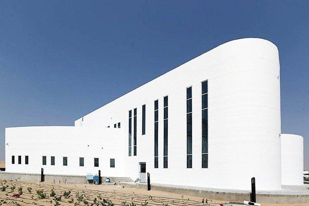 Фасад здания, напечатанного на 3D-принтере Apis Cor в Дубае
